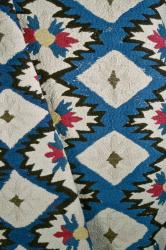 Embroidered colcha bedspread