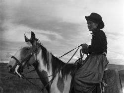 Navajo Woman on Horseback