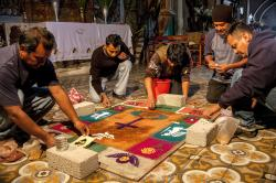 Men from the town preparing the Day of the Dead sand painting in front of the altar in the church in Teotitlán del Valle.