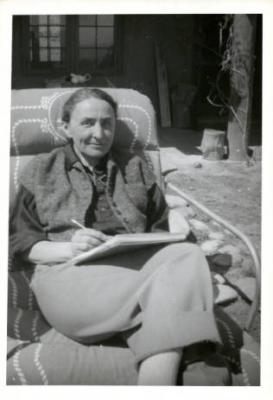Photo: Maria Chabot, Georgia O'Keeffe Writing Daily Letter to Alfred Stieglitz, Ghost Ranch House Patio, 1944. Gift of Maria Chabot. © Georgia O'Keeffe Museum