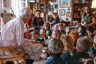 J. Paul Taylor reads to children at his Mesilla Home (contemporary, year & photographer unknown)
