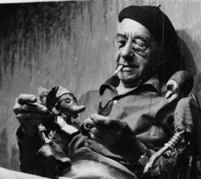Artist Gustave Baumann with his marionettes, Santa Fe, NM (1959) (negative number HP.2011.07.001) Palace of the Governors Photo Archive, New Mexico History Museum.