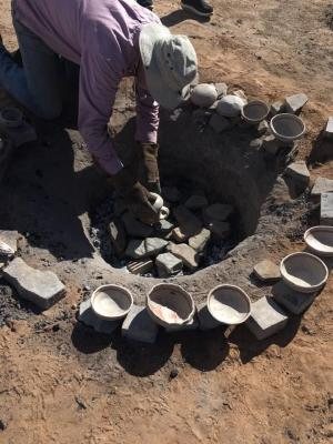 11-LOA-2018 Office of Archaeological Studies Director Eric Blinman removes recently fired ceramics during a presentation of ceramic production. Photographer: Amy Montoya, Photo Courtesy of Museum of Indian Arts & Culture