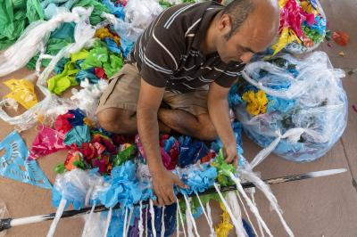 2-MOIFA-Gallery of Conscience Aymar Ccopacatty working on the community trash loom at MOIFA during the Arts Alive program, August 2nd 2018 Photographer: Chloe Accardi