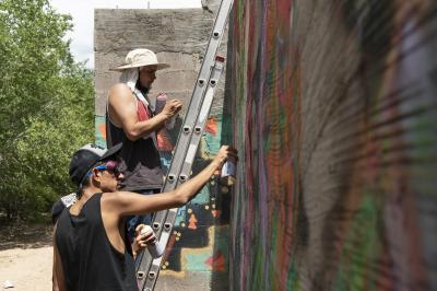 2-MOIFA-Gallery of Conscience Fernando Castro of Amapolay and Juan Lira painting at artist collective Alas de Agua's mural site in Santa Fe, June 27th, 2018  Photographer: Chloe Accardi