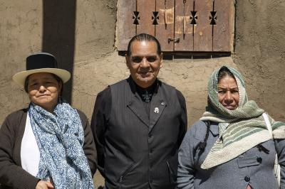 2-MOIFA-Gallery of Conscience :  Peruvian visitors Adelina Garcia, Wari Zarate, Rosalia Tineo Pause for a moment during a group visit to the Abiquiu Morada, April 9th, 2018    Photographer: Chloe Accardi