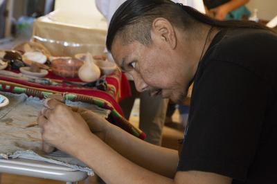 2-MOIFA-Gallery of Conscience: Wayland Sanchez sculpting his clay piece during a healing pottery workshop at Elder Kathy Wan Povi Sanchez' house, San Ildefonso Pueblo, April 10th, 2018    Photographer: Chloe Accardi