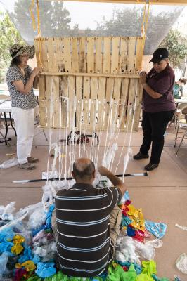 2-MOIFA-Gallery of Conscience: Aymar Ccopacatty working on the community trash loom at MOIFA during the Arts Alive program, August 2nd 2018  Photographer: Chloe Accardi