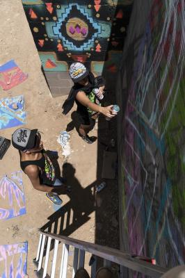 2-MOIFA-Gallery of Conscience : Carol Fernandez and Fernando Castro of Amapolay  painting at artist collective Alas de Agua's mural site in Santa Fe, June 27th, 2018   Photographer: Chloe Accardi