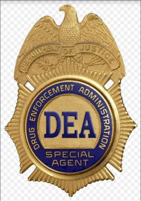 30-NMMNHS-Drugs Costs & Consequences  Image: Drug Enforcement Administration badge