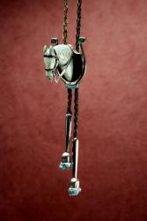Turquoise horse head mounted on horseshoe bolo with jet and turquoise inlay