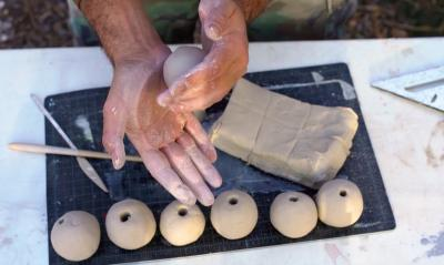 Hand Making A Clay Bead