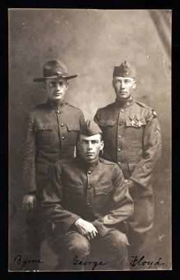 Byron, George and Floyd Wells, ca. 1919- The Wells brothers of Roswell were all Corporals, and they enlisted in 1918. Byron was the oldest and was in the Air Service. George, and Floyd were in the army. Floyd Wells, the youngest of the three, was awarded
