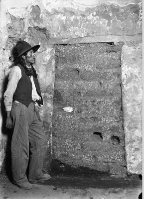 19-NMHM-Title: Unidentified man during restoration of the Palace of the Governors,  1912